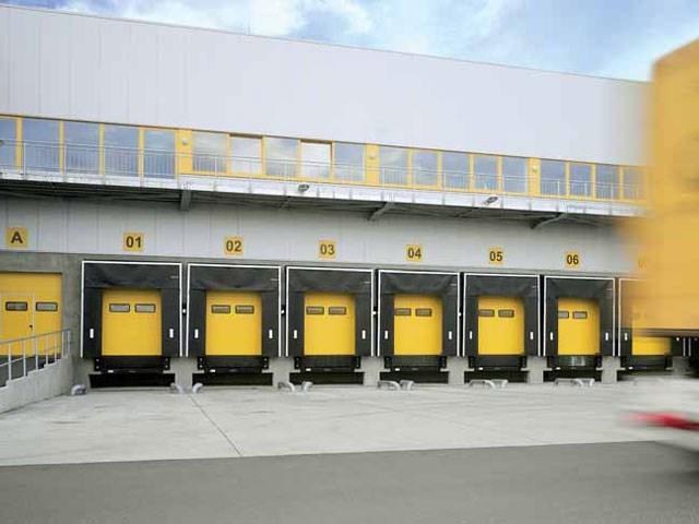 Pretovarna tehnika - Hörmann nudi kompletan program pretovarne tehnike pomoću perfektno usklađenog sistema utovarnih rampi, dihtung vrata i utovarnih tunela iz sopstvene proizvodnje.